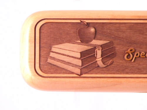 left side - strapped books with an apple on top